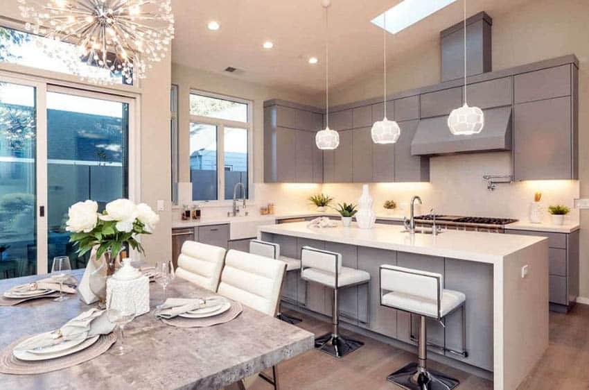Contemporary kitchen with l design eat in island gray cabinets quartz counters