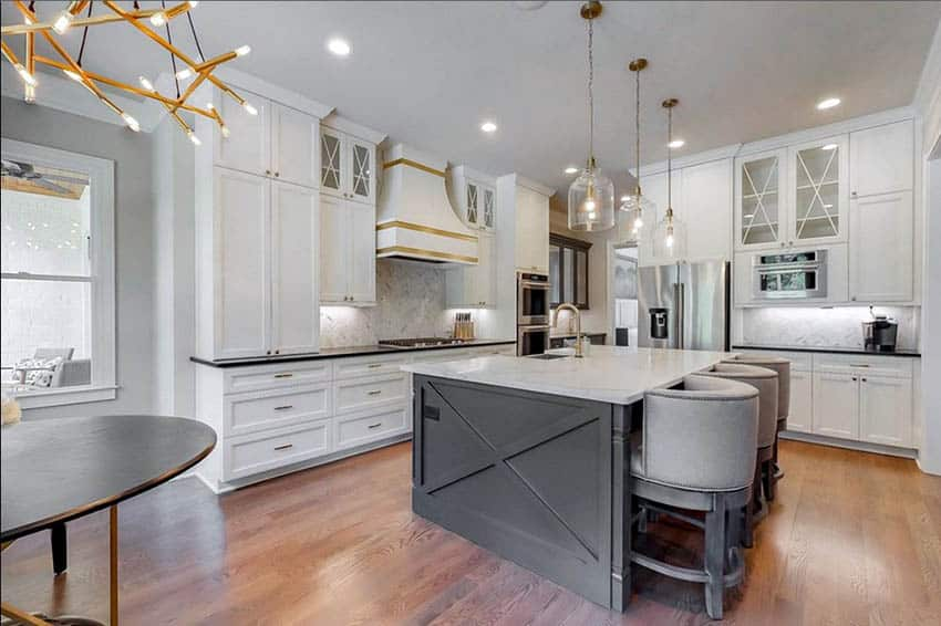 Contemporary l shaped kitchen with white cabinets gray island black and white countertops