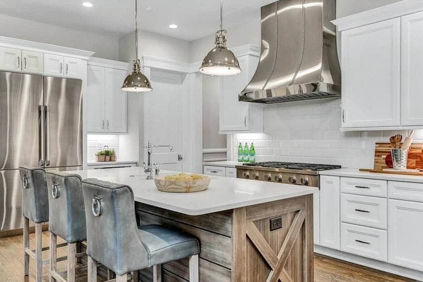 Corner kitchen with island with wood planks white quartz countertops