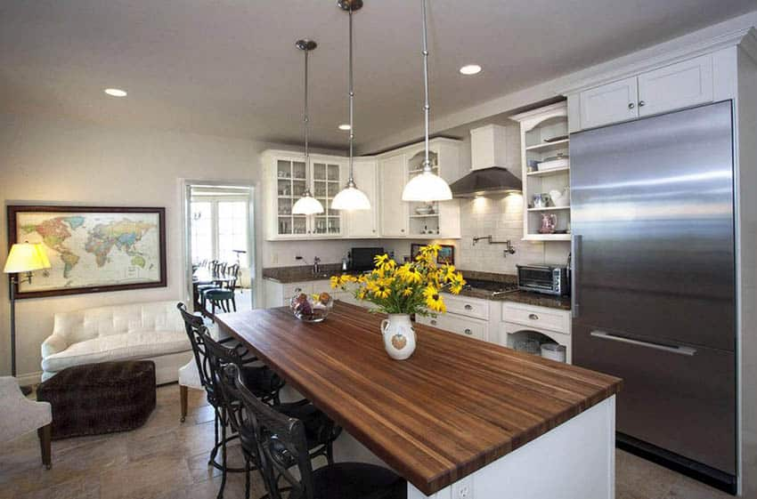 Country style l shaped kitchen with butcher block island