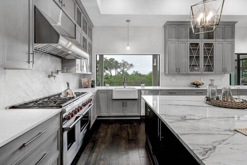 Kitchen with l shape island design gray cabinets quartz countertops