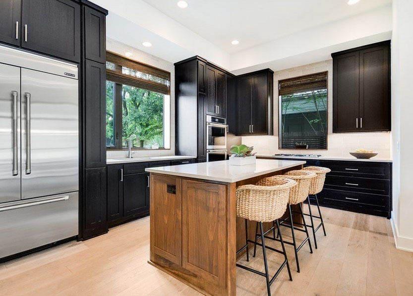 L shaped kitchen design with black cabinets light wood island quartz countertops