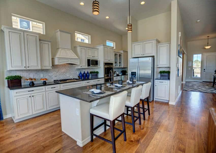 L shaped kitchen with island and distressed cabinets