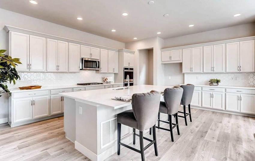 Large l shaped kitchen with island white cabinets octagon tile backsplash
