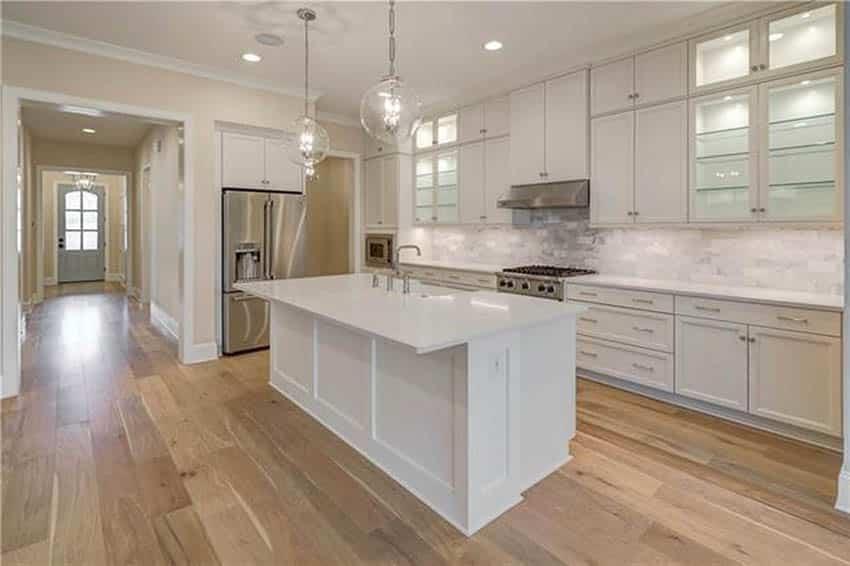 Long l shaped design kitchen with island with sink white cabinets