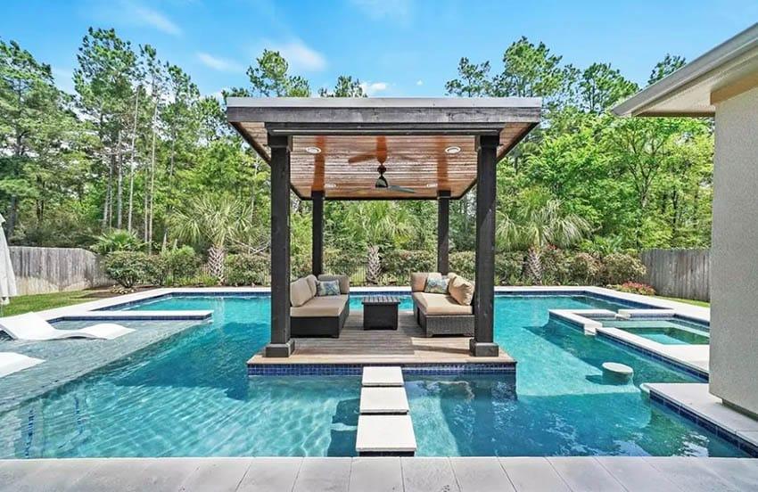 Luxury wood deck island over pool with cabana