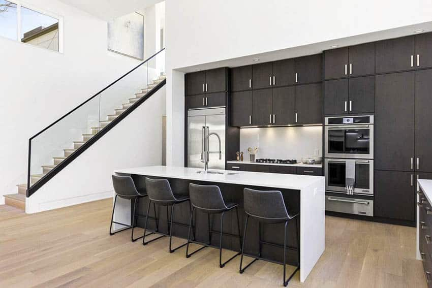 Luxury contemporary kitchen with l shape and dining island with sink