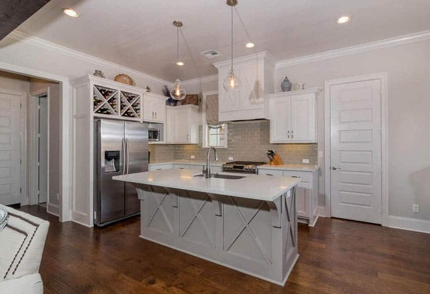 Small kitchen with l shape design and light green island white main cabinets