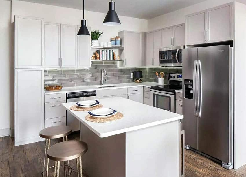 Small l shaped kitchen with island glass backsplash quartz countertops