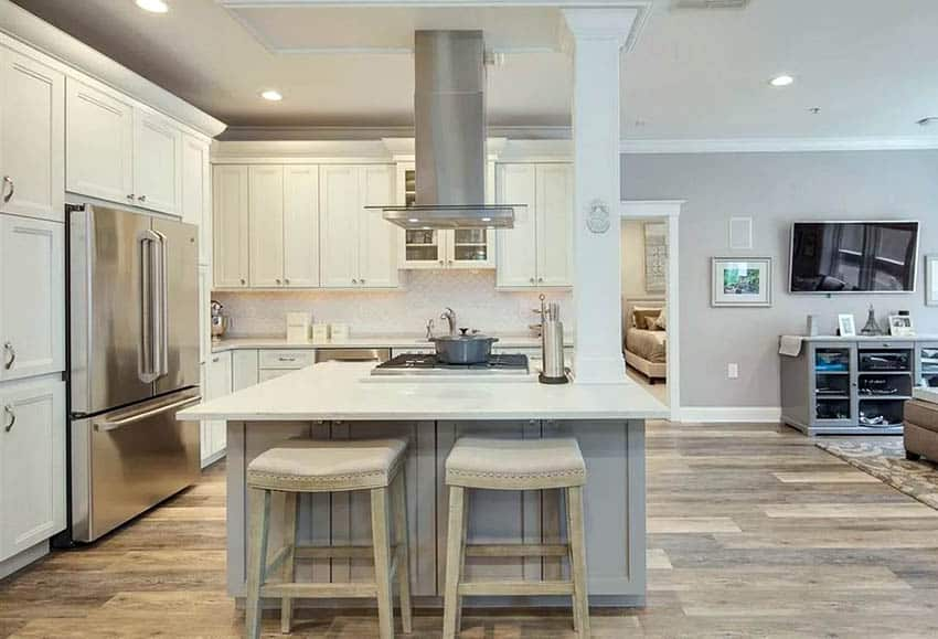 Small l shaped kitchen with white cabinets and gray island quartz countertops