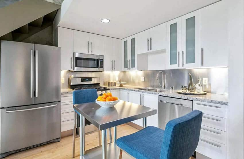 Small modern l shaped kitchen with stainless steel table island