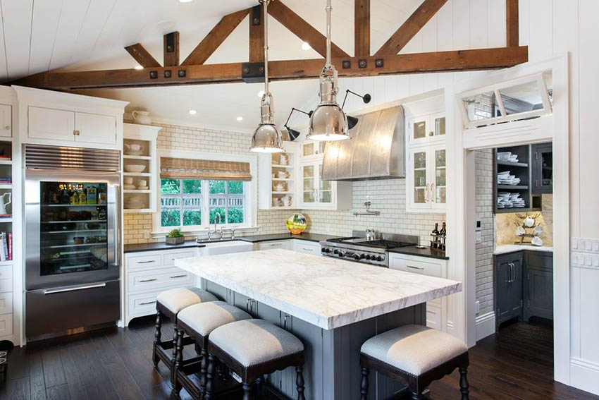Traditional l shaped kitchen with island subway tile backsplash shaker cabinets and butlers pantry