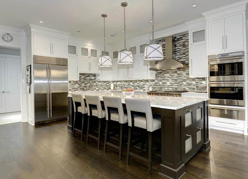 Traditional l shaped kitchen with white cabinets and dark wood island mosaic backsplash