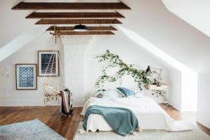 attic-bedroom-with-exposed-wood-beams