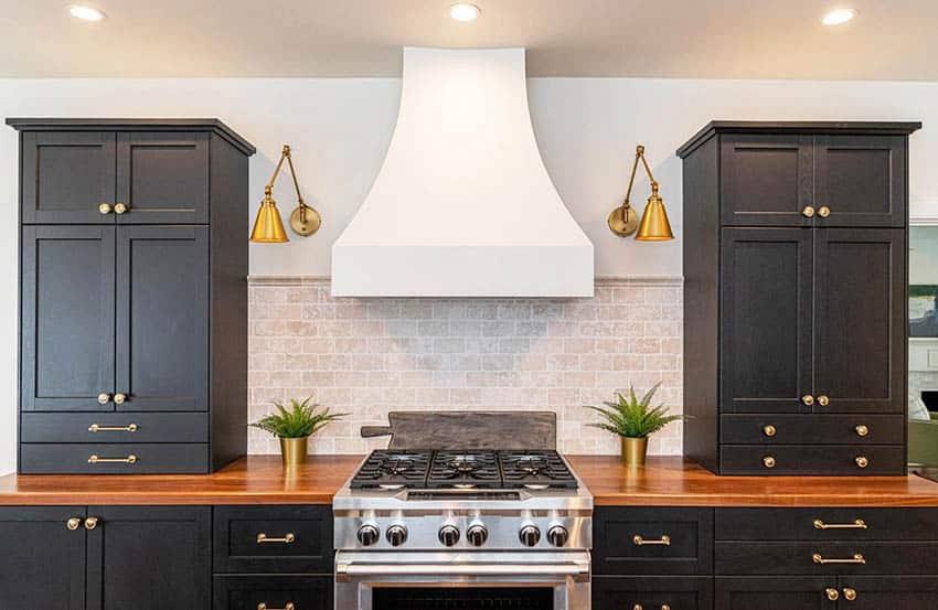 Kitchen with black cabinets amish walnut countertops brick backsplash