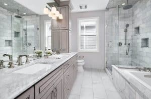 master-bathroom-with-calacatta-gold-marble-countertop-vanity-and-carrara-subway-tile-in-shower