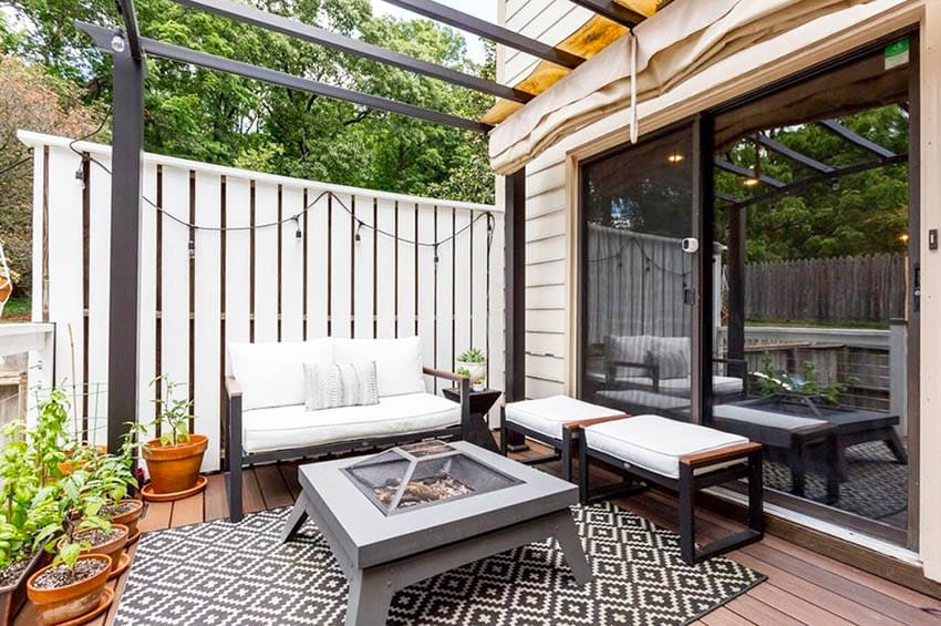 Small modern deck with pergola privacy fence and gas fire pit