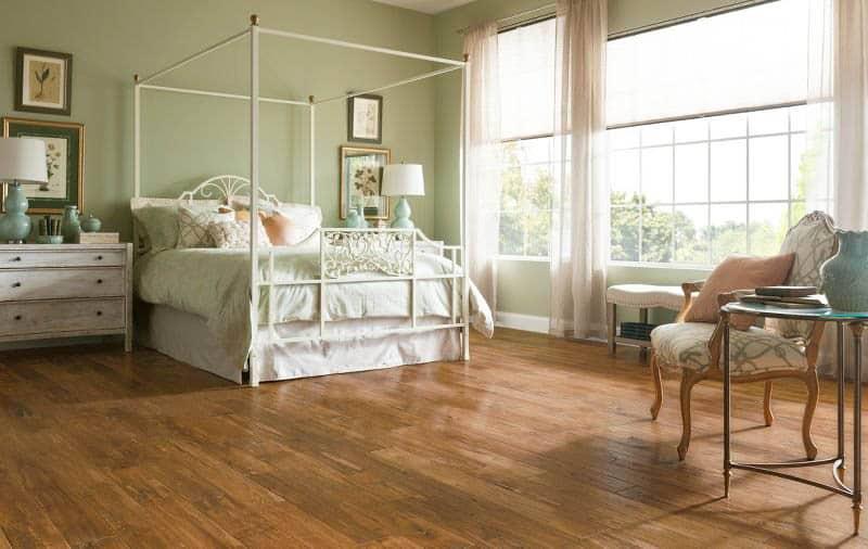 Hickory handscraped wood flooring in bedroom