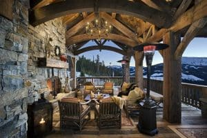 rustic-wood-deck-with-exposed-beams-and-outdoor-fireplace