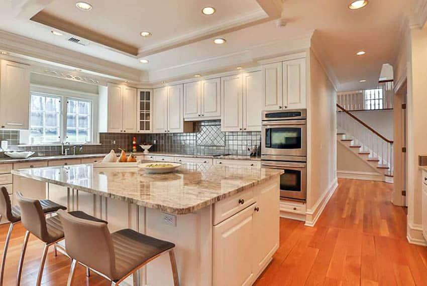 Prefinished maple hardwood flooring in white cabinet kitchen