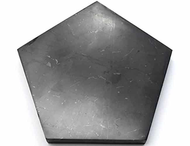 Pentagon tile made of polished stone