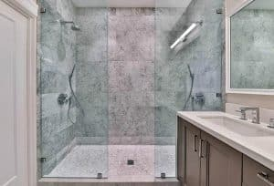 walk-in-marble-shower-with-mosaic-tile-floor