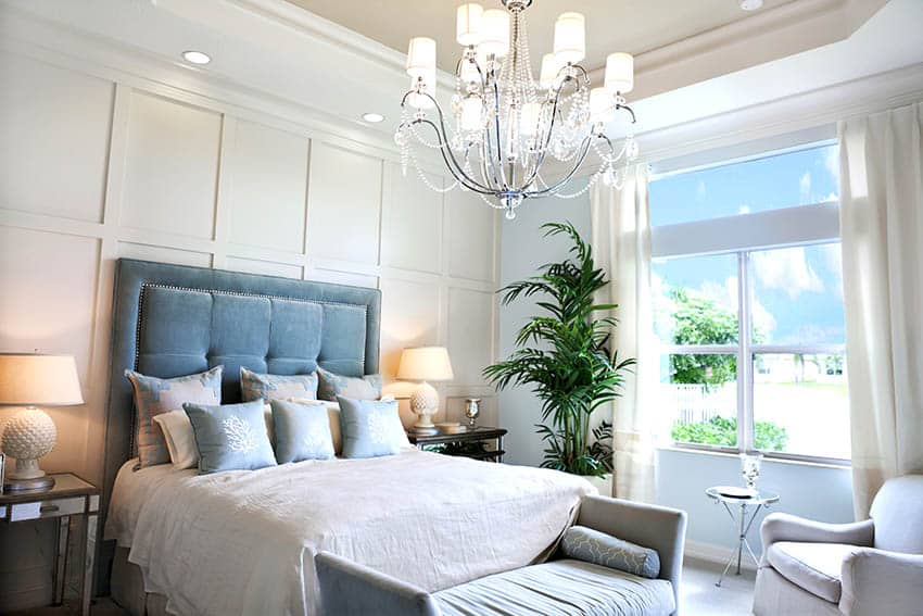 Beautiful bedroom with many pillows plush bed headboard