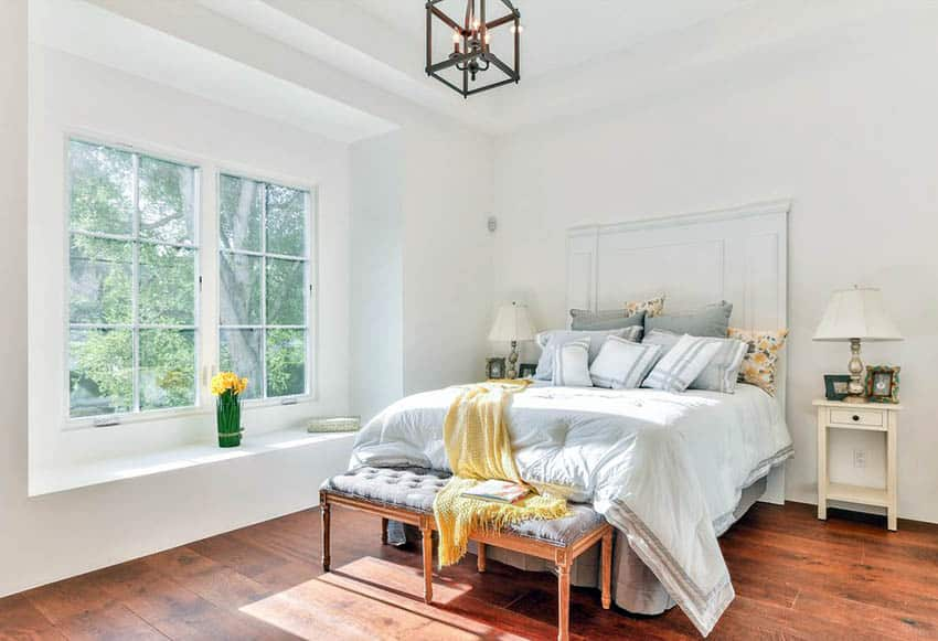 bright-bedroom-design-with-bed-with-large-mattress-and-headboard-and-hardwood-flooring