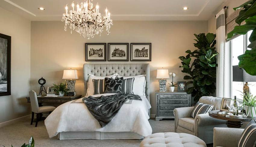 Contemporary bedroom with queen mattress tufted bed frame and glass chandelier