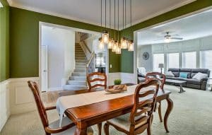 dining-room-with-bright-green-paint-and-white-wainscoting