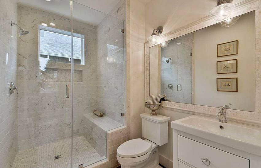 bathroom-with-single-handle-faucet-marble-shower-with-bench