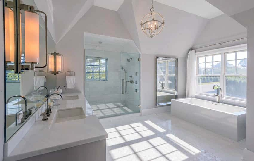Contemporary bathroom with dual sinks carrara marble and bathtub with view