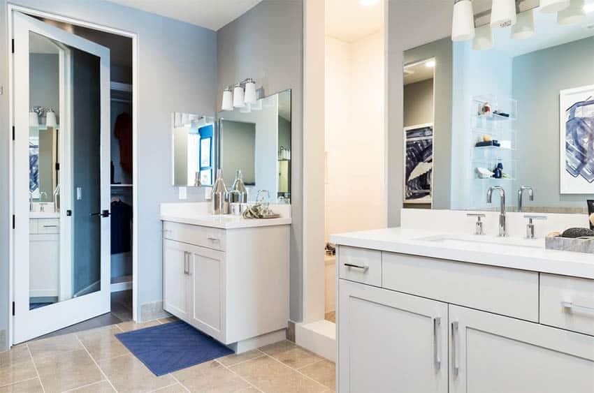contemporary-master-bathroom-with-quartz-dual-vanity-two-sinks-travertine-flooring