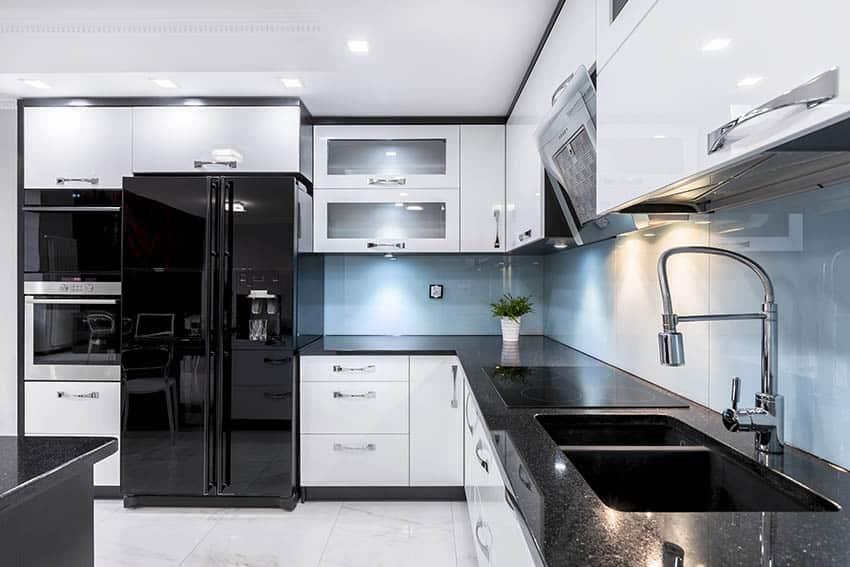 Modern black kitchen cabinets with white doors blue glass backsplash