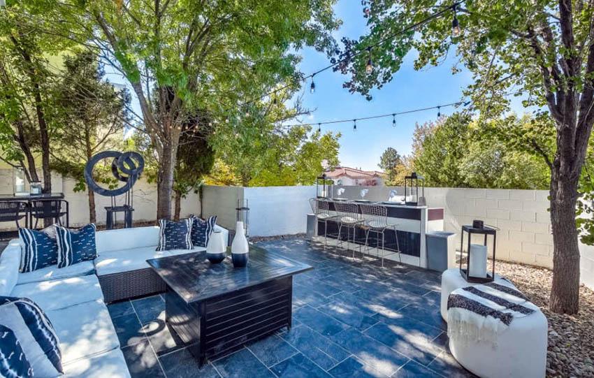 Backyard patio with slate floor tile and outdoor bar