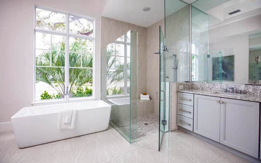 Bathroom with porcelain tile flooring and shower with tub and window view