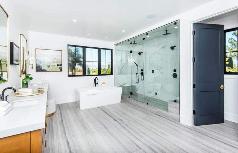 Bathroom with vinyl sheet flooring and large marble shower