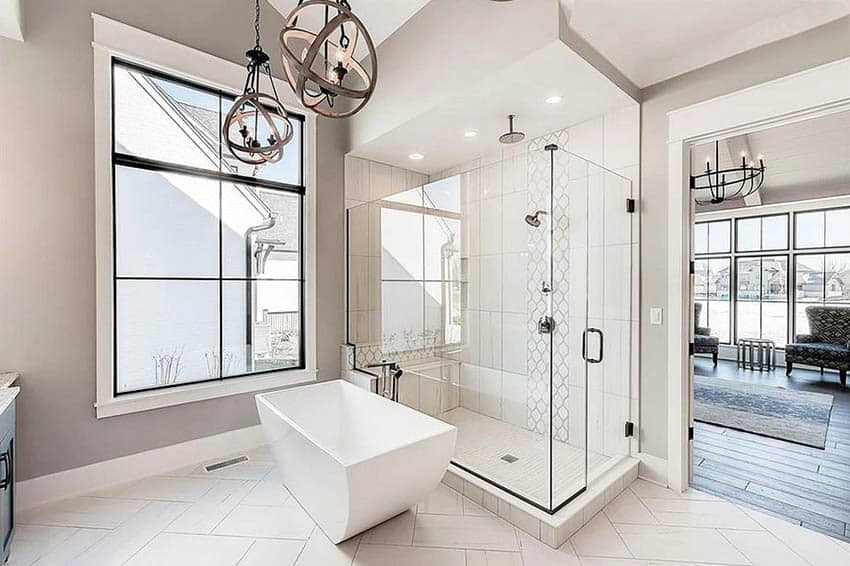 Contemporary master bathroom with ceramic tile flooring, rainfall shower and globe lighting