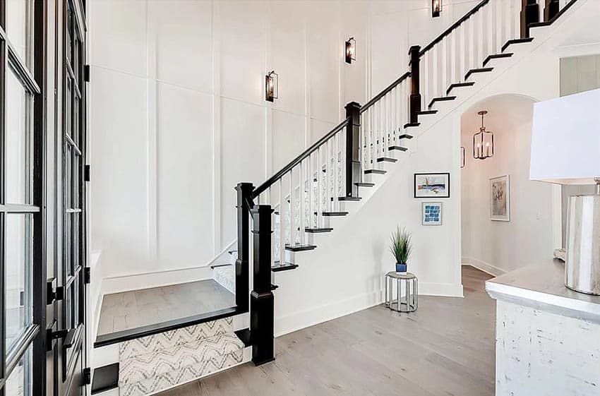 Foyer with white traditional style stair railing