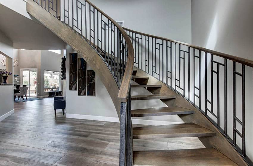 Foyer with wood and metal stair railings