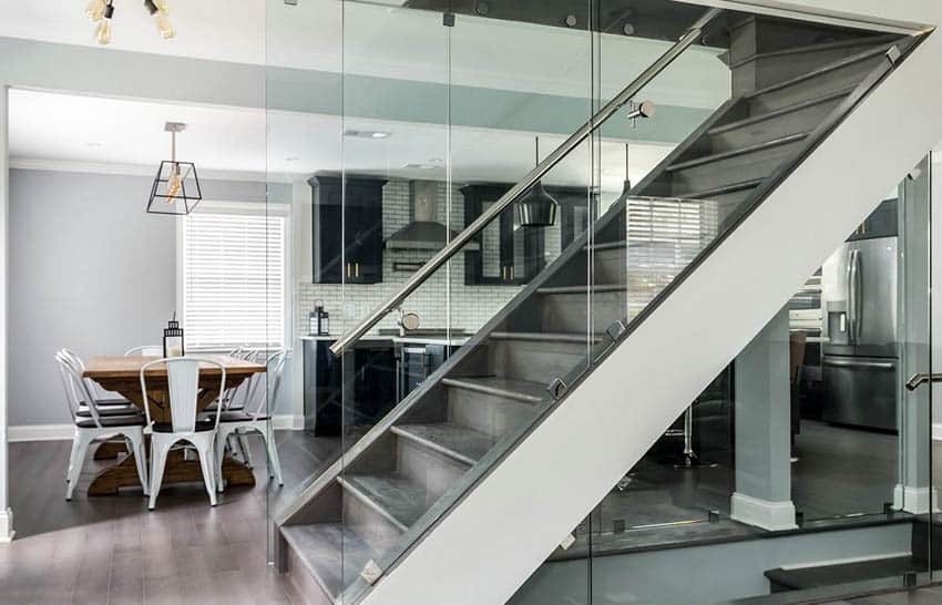 Staircase with metal railings and glass partitions