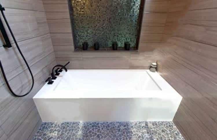 Alcove tub inside shower area
