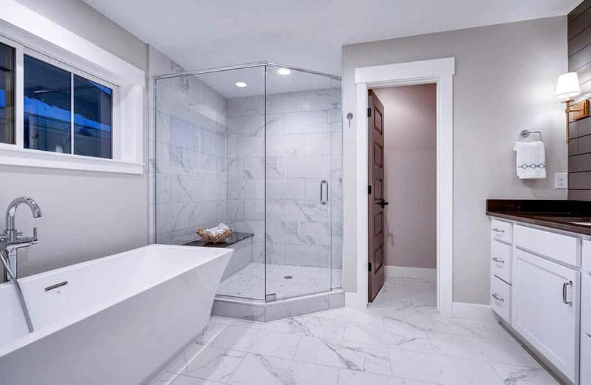 Bathroom with marble shower and bench