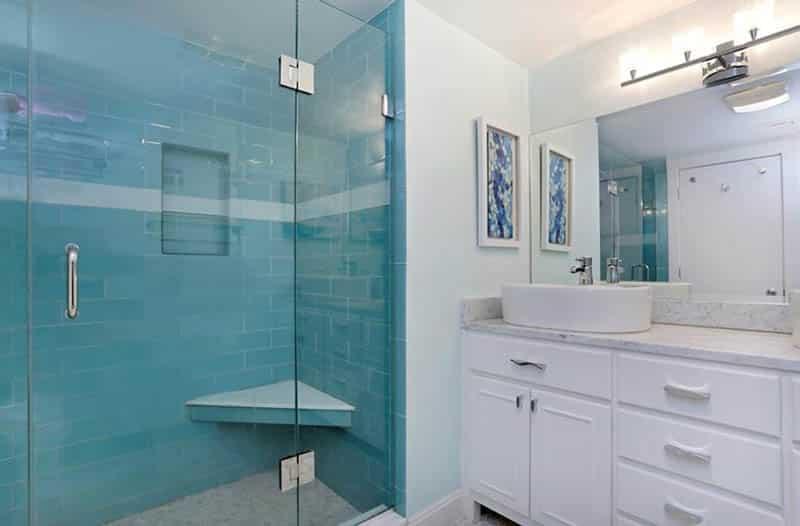 Blue tile shower with corner bench