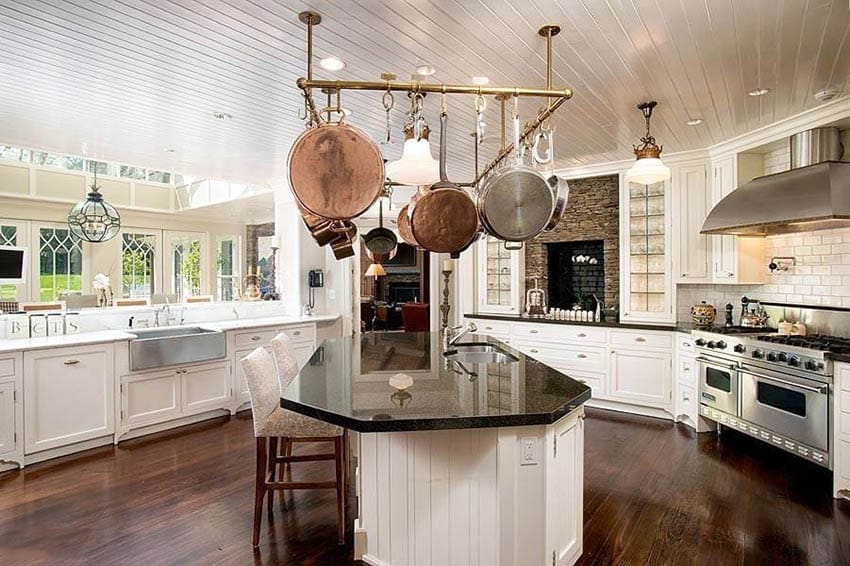 Contemporary kitchen with white cabinets absolute black granite countertops and eat in island