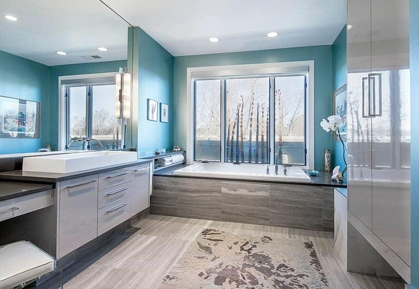 Contemporary master bathroom with alcove bathtub