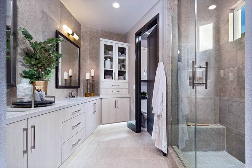Contemporary master bathroom with granite shower and bench