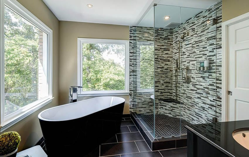 Contemporary master bathroom with shower and granite bench seat