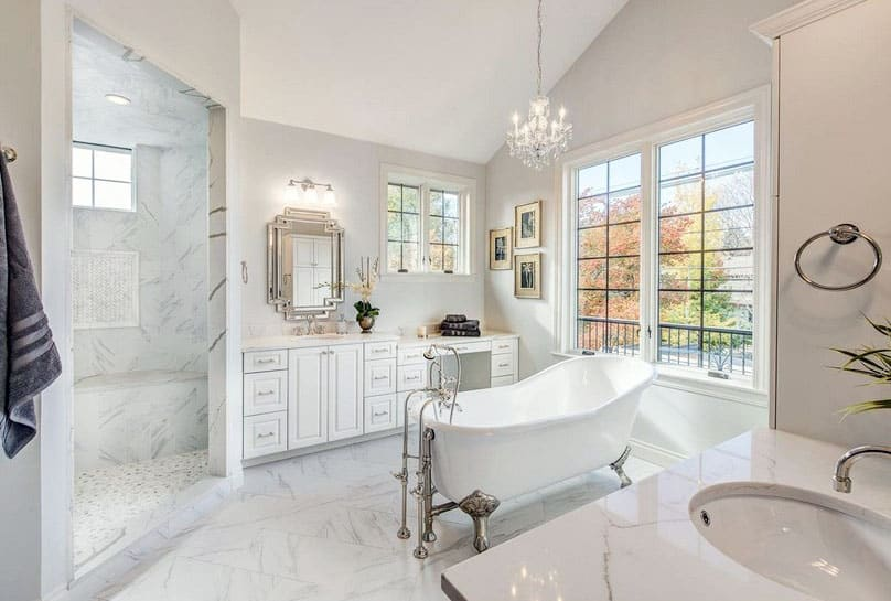 Luxury bathroom with marble shower bench and claw foot tub