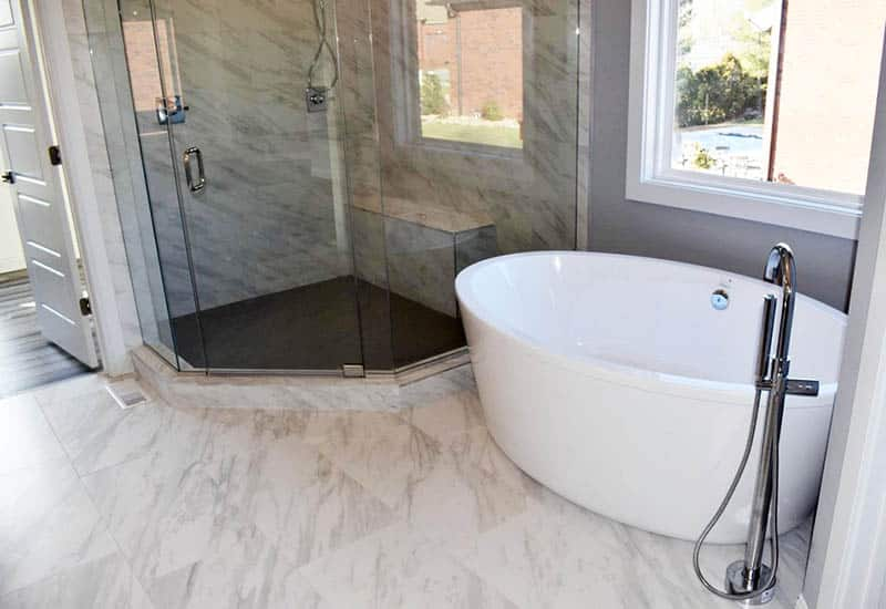Marble bathroom with shower and bench